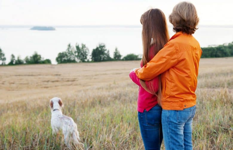 Mother and daughter with their Irish Setter dog