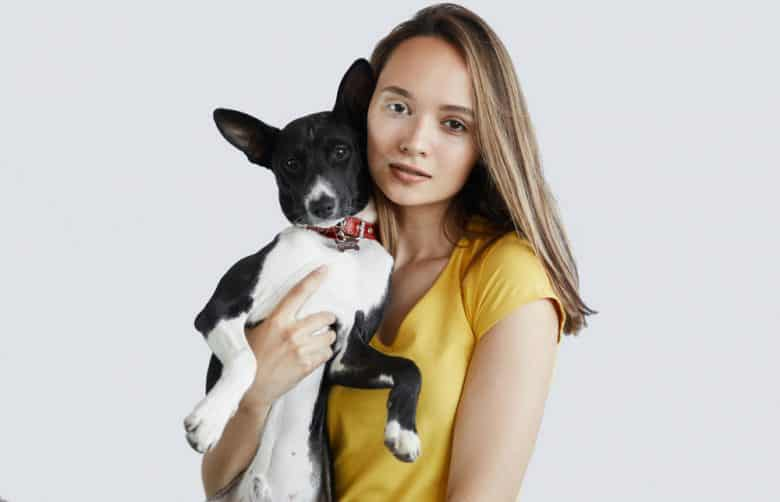 Young woman holding a dog