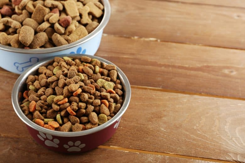 two dog bowls with two types of dog food