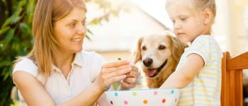 Family with their dog peeling peas together